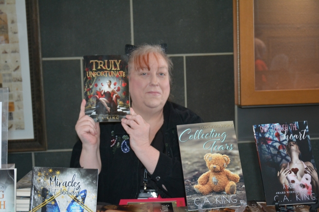 C.A. King with copy of her book True Unfortunate