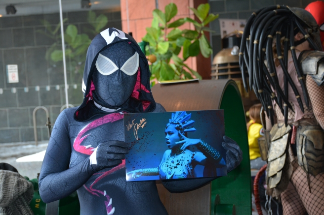 Kait Possible as Venom holding picture of herself as Akasha ( played in movie by Aaliyah)